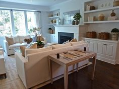 simple mantle, wood floors, built-ins, layout | Kensett Norwood. Pastel blue and white/cream