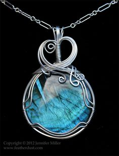 A pendant of Labradorite carefully hand wrapped in Argentium sterling silver. ( Jennifer Miller of Featherdust Studio)