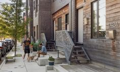 """To create attractive street-level social spaces, ISA created """"super stoops,"""" a sequence of entry platforms in front of the homes large enough for impromptu gatherings with steps that double as seating."""
