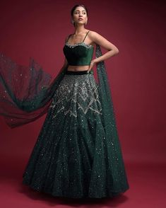 A glorious celebration of dark and happy all-things-glittery embroideries, the jewel-toned emerald green velvet lehenga explores the age-… Designer Bridal Lehenga, Indian Bridal Lehenga, Indian Wedding Outfits, Indian Outfits, Ethnic Outfits, Indian Clothes, Embellished Crop Top, Green Lehenga, Lehenga Designs