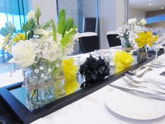 Fill in a long table centrepiece with coloured paper pompoms. Styled by @Beedazzled Events  at The Surf Club Mooloolaba.