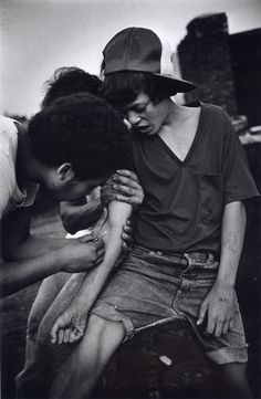 An 11 year-old boy tries heroin on rooftop. The Bronx, New York, 1977