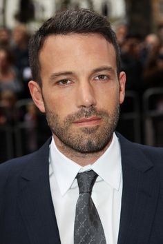 Ben Affleck Town Suave and sophisticated Ben Affleck! You Think! There's more on our website! http://celebzis.com/ben-affleck-massive-back-tattoo-is-the-real-deal/