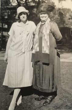 1920s Young woman on the Left and her mother on the Right in clothing styles of the late1910s