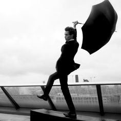 Eddie Redmayne is trembling in the wind - he could fly away with the umbrella like Mary Poppins