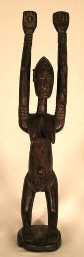 Figures with raised hands are among the most common types of sculptures in Dogon art.  Many meanings have been given to figures with raised hands. Raised hands have been interpreted  as communication between the heavens and the earth. Later evidence shows that it may have also  represented gestures made during actual Dogon rituals.