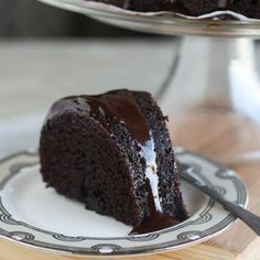 One bowl Guinness Cake- Super Moist, Super Indulgent and Super Easy- Less than 5 minute prep! Drizzled with a shiny ganache.