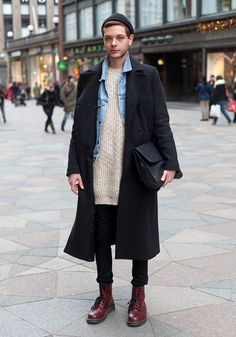 "Roope, 21 ""My coat and beanie are from Weekday, the denim vest Weekday vintage, the knit H&M, the bag is vintage and the shoes Dr Martens. I often buy oversized clothes and I also like to shop at women's department. Vivienne Westwood and Kate Moss inspire me."" 30 November 2013, Keskuskatu"