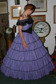 Simply exquisite, this gorgeous Flounced Quinceanera Gown features row after row of lace trimmed ruffles. The cotton bodice has a black cotton waist insert, which makes the waist seem even smaller in comparison. Southern Belle Dress, Civil War Fashion, Old Fashion Dresses, Period Outfit, Historical Clothing, Ball Gowns, Belle Outfit, Formal Dresses, Elegant
