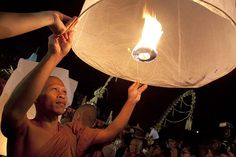 Magelang, Indonesia. During the Waisak [Buddhist] Festival, the monks complete three circles of the Borobudur temple while praying and then release 1000 wishing lanterns to the full moon.