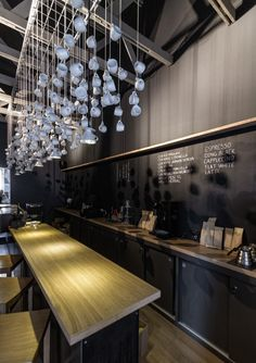 "For the installation: ""Origo Coffee Shop / Lama Arhitectura - lighting and chalk wall - simple sleek"""