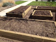 Dave measures and lays out the square foot grids for the planter beds. (03/11/12)
