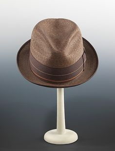 A growing informality of American dress after World War II meant fewer men owned an array of hats, but several basic styles endured as men returned to work after their war service. Suits had a more tapered fit in the 1950s and a trimmer hat, like this narrow-brimmed fedora, complemented the trend