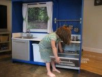 a repurposed old tv stand into a play kitchen.My dad will make me this if i have a girl one day!