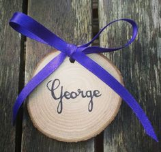Hand made wooden name place settings which double up as a lovely keep sake favour for your guests. www.oh-so-sweet.co.uk