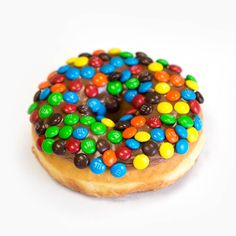 Hand-cut yeast donut -- topped with milk chocolate frosting and M&Ms.