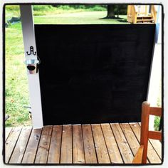Convert a wall of your playhouse into a chalkboard! Prime and use Chalkboard paint. Decorative hook and small bucket hung on the wall to store the chalk.