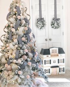 King of Christmas flocked tree decked out in all the black, white and blush ornaments and ribbons! Perfect for a little princess's bedroom. Halloween Christmas Tree, Black Christmas Trees, Creative Christmas Trees, Traditional Christmas Tree, Ribbon On Christmas Tree, Christmas Tree Design, Beautiful Christmas Trees, Colorful Christmas Tree, Christmas Tree Themes