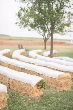 hay bale seating at the ceremony | Michelle Boyd #wedding I usually don't like the idea of hay bales but I actually really like this.