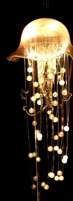 This jellyfish chandelier measured around 2 metres long, and had two lighting circuits. The primary circuit lit up the bowl and the acrylic spheres via fibre optics, the second lit up the glass tentacles. This chandelier reacted to sound. Jellyfish Light, Jellyfish Facts, Jellyfish Drawing, Jellyfish Painting, Jellyfish Tattoo, Pink Jellyfish, Jellyfish Quotes, Jellyfish Sting, Watercolor Jellyfish