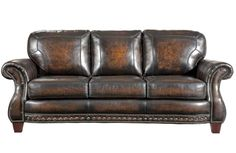 and a classy leather couch (for when he wants to spread out more)  [found here: http://www.ebay.com/itm/Broyhill-Stetson-Hand-Rubbed-Leather-Sofa-/160565990960]