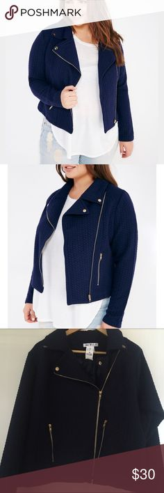 Navy Textured Jacket A soft knit jacket featuring a textured pattern, gold zipper pockets at the front, and snap button detailing on the collar.  Model wears a size 1X.  Notched Collar Zip Front Mid-Weight Lined Long Sleeves Polyester / Spandex Machine Wash Imported Wet Seal Jackets & Coats