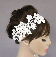 Lace bridal fascinator, weddings headband in venetian lace applique, pearl beads embroidered, handmade. $42.00, via Etsy.