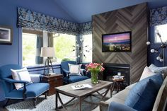 We went bold with blue! An eclectic mix of mid-century modern, traditional and french-inspired elements are centered around a herringbone-tiled fireplace in the warm and welcoming living room. >> http://www.hgtv.com/design/hgtv-urban-oasis/2015/living-room-pictures-from-hgtv-urban-oasis-2015-pictures?soc=pinterest