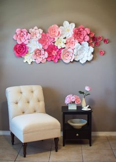 These gorgeous handmade flowers would be beautiful as a backdrop for a wedding, bridal shower, or even as a statement piece in the home or retail boutique. This listing is for 15 regular sized paper flowers and 7 mini-paper flowers that have been hand crafted from premium card stock paper. The featured colors are pinks, cream, and white. The largest flowers measure between 12-14 inches in diameter and the mini flowers measure about 3 inches in diameter. The flowers are displayed in an array…