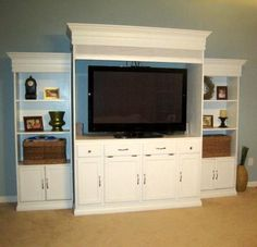 See how they built this huge tv cabinet from a bathroom vanity and some plain bookcases!