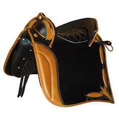 A beautiful version of our Prince of Persia saddle in black leather combined with natural leather. This saddle is the result of meticulous craftsmanship custom made for a movie. A saddle fit for a prince. With cortezia rings and ornaments.