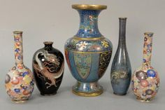 Five cloisonne vases including a pair of small bottle form vases with blossoming lotus and flowers, two 3 claw dragon vases, and a large enameled vase with geometric designs