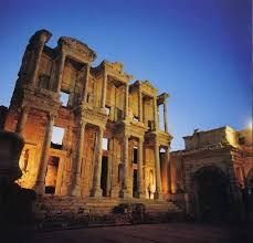 The library of Celsus is an ancient Roman building in Ephesus, Anatolia, now part of Selçuk, Turkey. It was built in honor of the Roman Senator Tiberius Julius Celsus Polemaeanus. The library was built to store 12,000 scrolls and to serve as a monumental tomb for Celsus. Celsus is buried in a sarcophagus beneath the library, in the main entrance which is both a crypt containing his sarcophagus and a sepulchral monument to him.