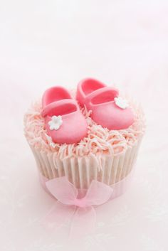 Pink cupcake decorated for a little girl.  So cute for a baby girl baby shower