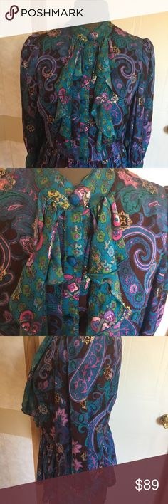 Pepulm silk blouse by Anna sui Beautiful ruffle front pepulm silk blouse. Teal, purple and green with accents of gold. Bottom front closure. 87% silk, dry clean only. Look lovely for a night out or at the office with a pencil skirt. Anna Sui Tops Blouses