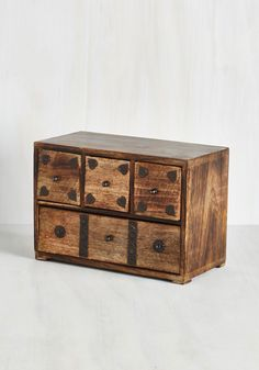 Four Drawers and Seven Years Ago Chest. Keep your mementos adorably organized inside this whimsical wooden chest! #brown #modcloth