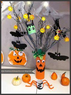 - ce week end nounou a fait sa déco pour halloween , rien qui fait peur pour les petits !! et pour changer de notre arbre photo j'ai réalisé un arbre d'halloween citrouille ... - A partir d'une boite de pringles remplie de petit caillou de déco ou tout...