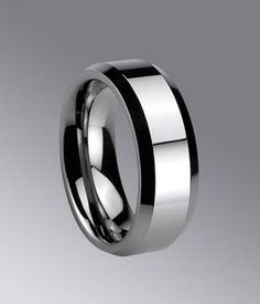 Twinkling & elegant. 7mm high polished shiny tungsten carbide wedding band is sure to be fashion and contemporay.
