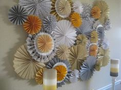 How to make a color coordinated paper pinwheel backdrop for the wall of your baby shower or party venue.