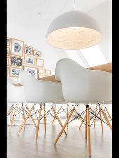 Vitra Charles Eames Plastic Chair, Skygarden Flos, Oak table