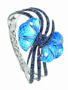 FORGET ME KNOT BRACELET BY STEPHEN WEBSTER |  black opal, black diamonds, blue sapphires in white gold