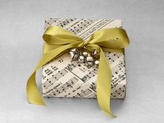 Karen Bartolomei of Grapevine invitations repurposed Jingle Bells sheet music to create a whimsical package with festive cheer. She enlarged the music on a copier, and then printed it onto thick paper. A satin bow and jumble of — what else? — jingle bells provide the finishing touches.