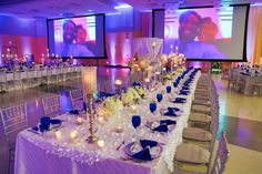 Our Royal Blue and White Wedding - Blue Wedding Reception Decor - Candelabras - Blue Goblets - Silver Chargers - Candles - Ivory Linen - Hydrangeas Roses Centerpieces - Family Styled Reception Seating - Black African American Elegant Wedding
