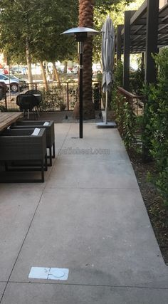 This hotel has installed Sunglo PSA265 patio heaters and Tropic Heating's patio heater flush underground vault boxes.  The vault box noted without the heater installed is at the ready if a heater is needed in that location.  Perfect for residental and commercial applications