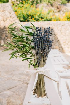 Little touches - lavender and olive tied to the aisle ceremony chairs