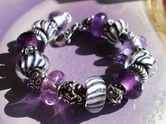 Purple & Wolfs :-)  From a German collector on Trollbeads Gallery Forum!  Such great inspiration for all collectors. Please join us! http://trollbeadsgalleryforum.ning.com/
