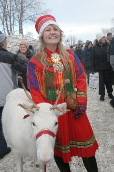 Saami girl and a white reindeer in the reindeer parade at the Jokkmokk Winter Market, Sweden. Sami, Jokkmokk Market: Arctic & Antarctic photographs, pictures & images from Bryan & Cherry Alexander Lappland, Folk Costume, Costumes, Sweden, White Reindeer, Scandinavian Countries, People Of The World, World Cultures, Traditional Outfits