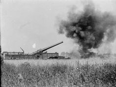 MINISTRY INFORMATION FIRST WORLD WAR OFFICIAL COLLECTION (Q 916) 12-inch Mark IX gun on railway mounting in action; Meaulte, September 1916.