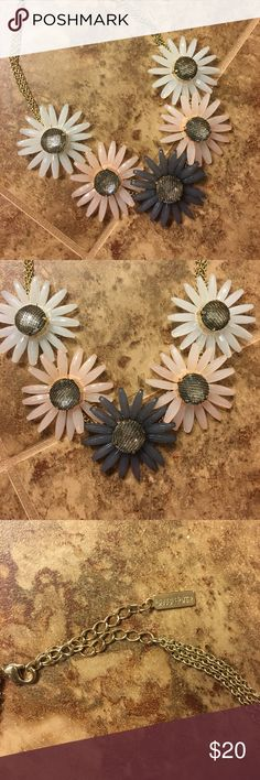 BaubleBar floral statement necklace EUC adorable statement necklace with large daisies and a gold chain. The centers of the flowers are rhinestones covered with a metallic mesh. Super cute with a buttondown, v-neck tee, and so much more for summer! BaubleBar Jewelry Necklaces