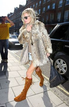 Kate Moss looking fabulous (as usual) in the Minnetonka Knee-Hi Frong Lace Moc boots. $84.95 at www.doddsshoe.com